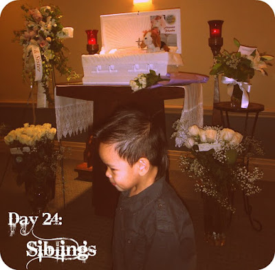 little brother with our baby during funeral visitation