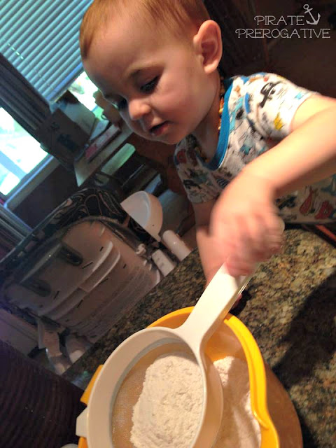 My assistant helping to sift the dry ingredients