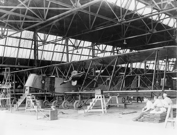 Workers relax after completing work on a Martin Bomber, ca. 1920