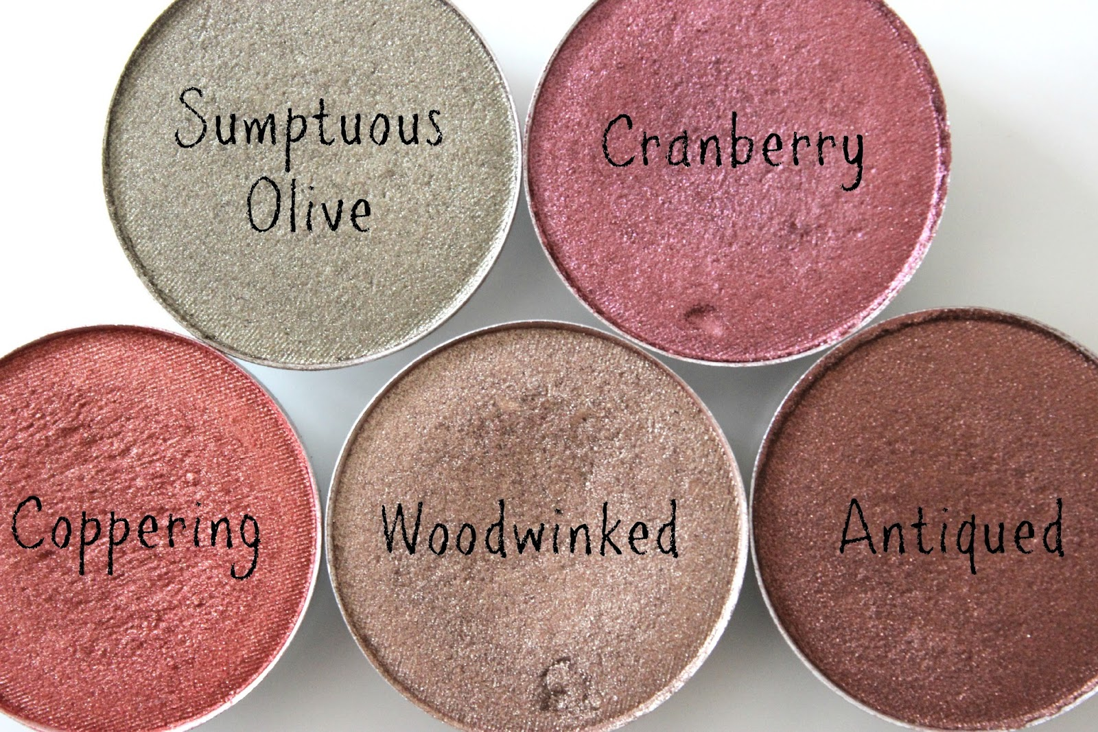 A picture of MAC Sumptuous Olive, Cranberry, Coppering, Woodwinked and Antiqued eyeshadows