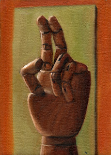 Oil painting of a wooden artist's model hand, with middle and index fingers extended.