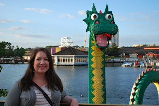 Megs standing in front of a Lego sculpture of a dragon outside the Lego store in Downtown Disney.