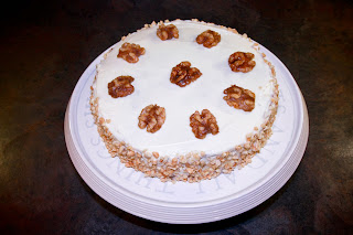Carrot cake with ceam cheese frostinng and caramelised walnuts