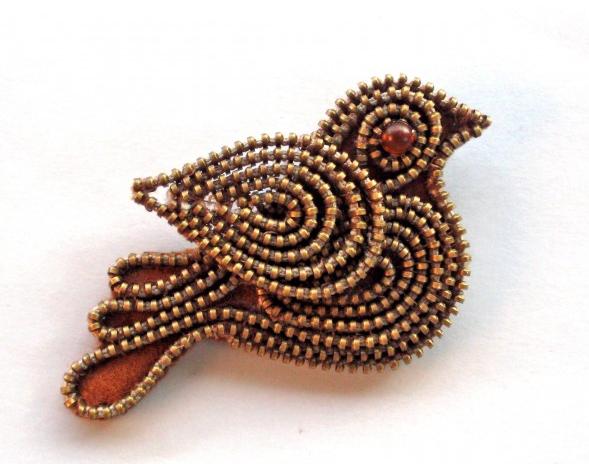 Broche de pájaro hecho con cremallera