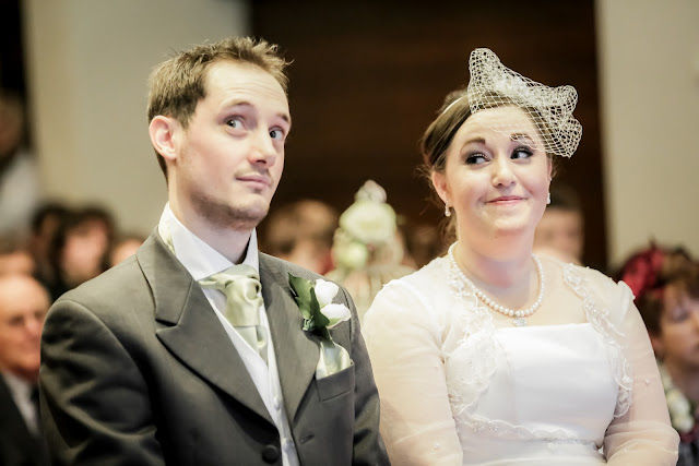 bride and groom pulling faces when asked if anyone had anything to declare