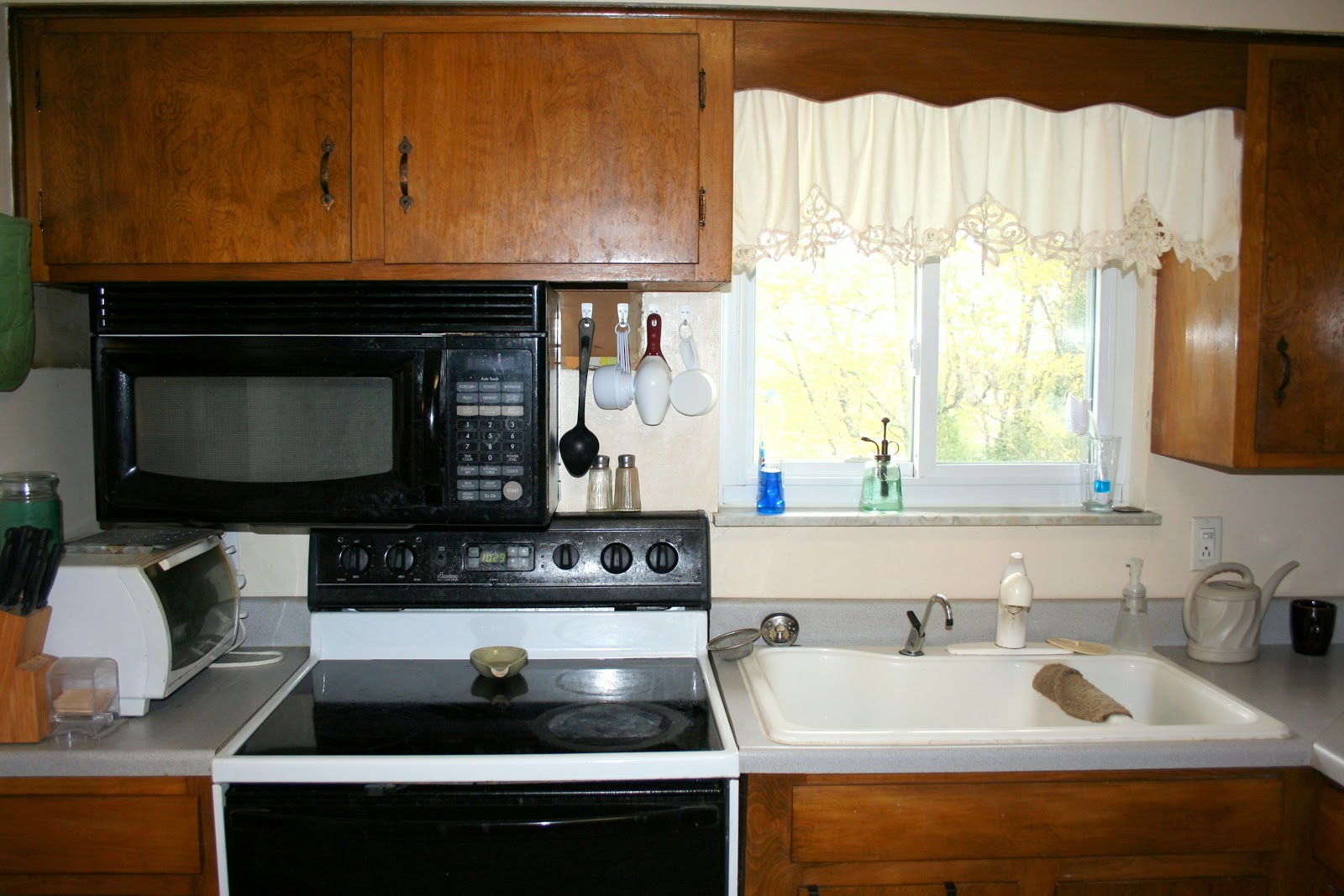 Kitchen stove next to sink images