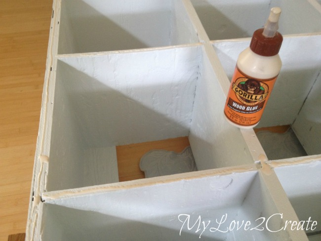 MyLove2Create, Cubby Shelf Revamp, using wood glue and nails to attach trim