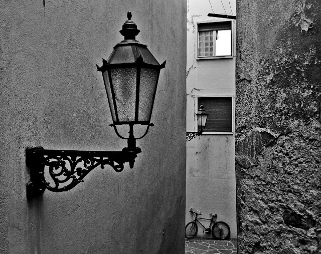 Sion Vallis Old town two lamps and bicycle