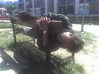 funny picture: drunk sleeping on a park bench