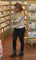 Hilary Duff talking on the phone in a gift store