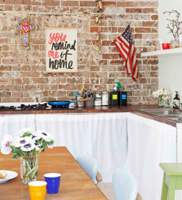Coastal kitchen with exposed brick