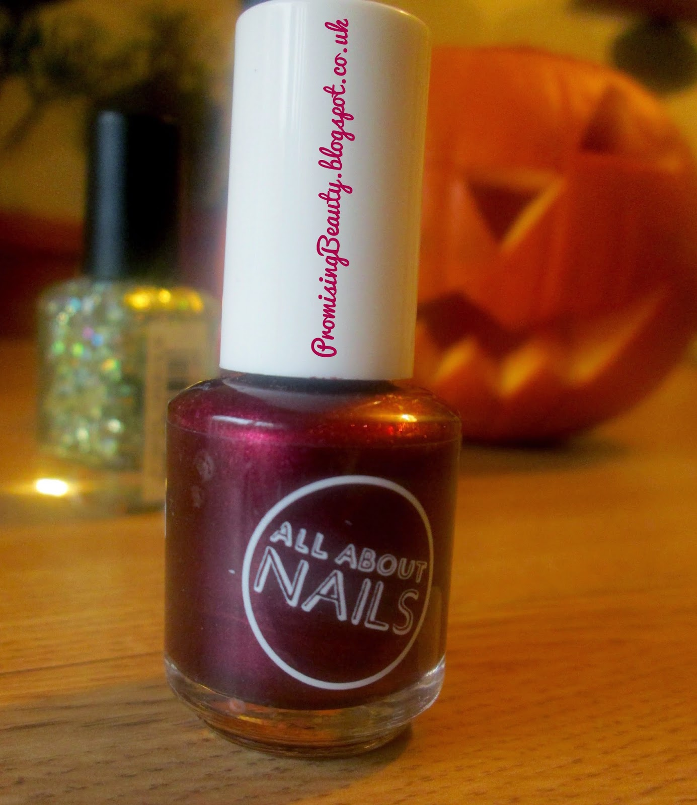 Burgundy, deep red nail polish and halloween pumpkin