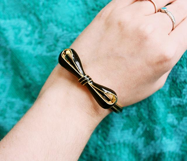 bow bracelet on turquoise blanket