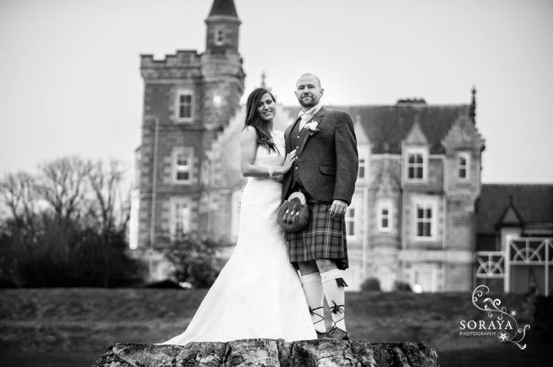 bride and groom outside ardoe house hotel in aberdeen in wedding attire