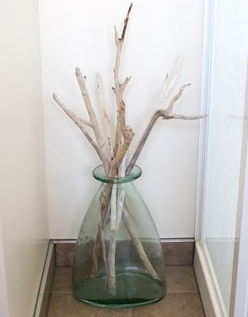 Natural driftwood for a spa like bathroom completely coastal for Bathroom decor vases