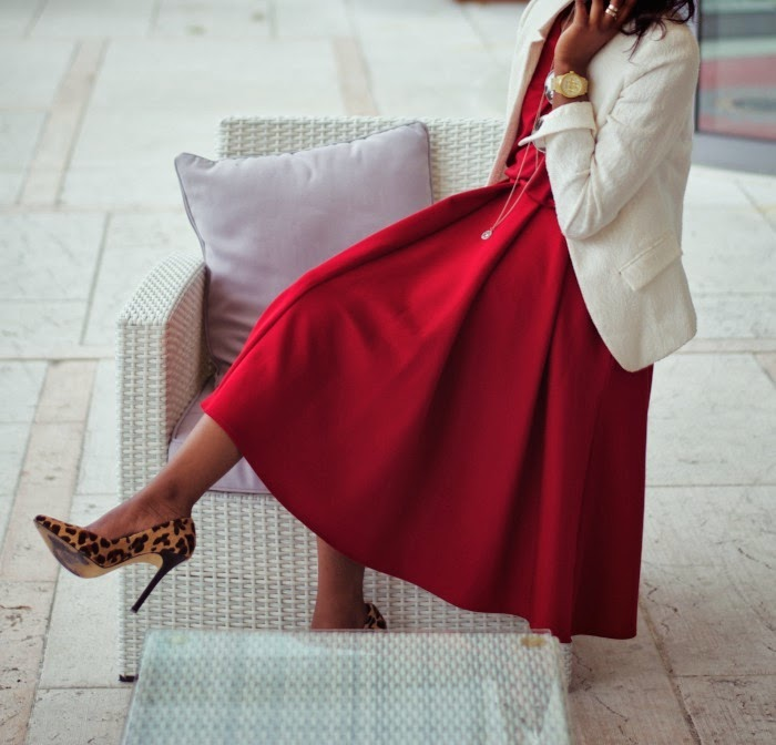 nia in red midi skirt and leopard print heels
