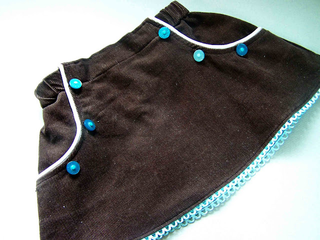 http://leafytreetopspot.blogspot.com/2011/05/piped-pocket-infant-skirt-pattern-and.html