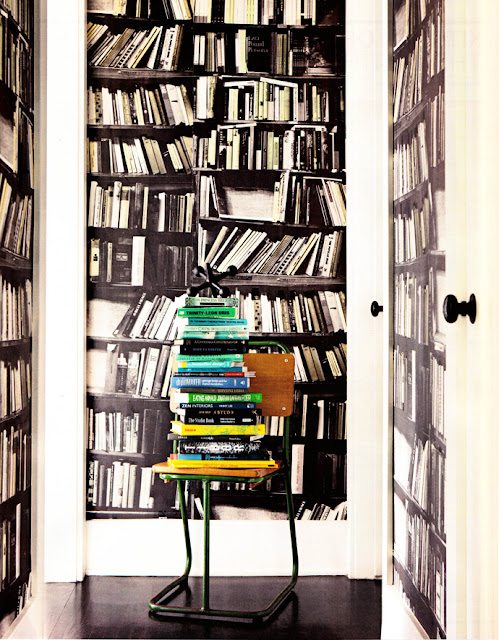 Library, books on chair, chair as shelf