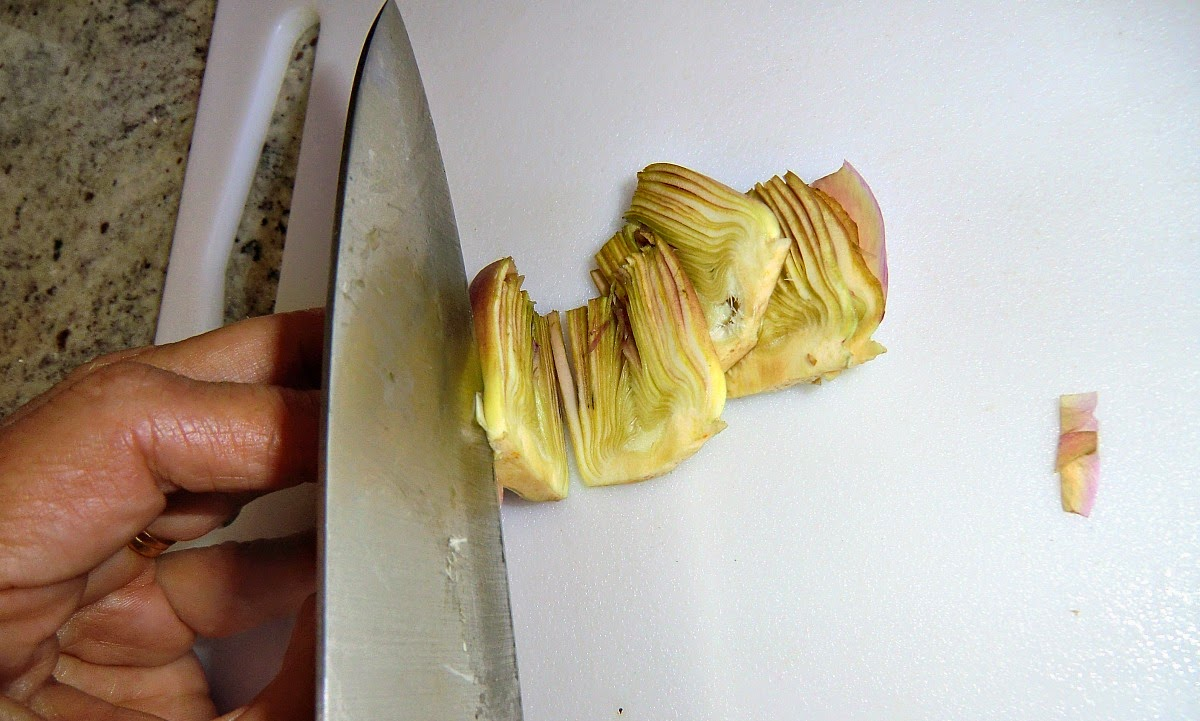 Thinly slice the artichokes