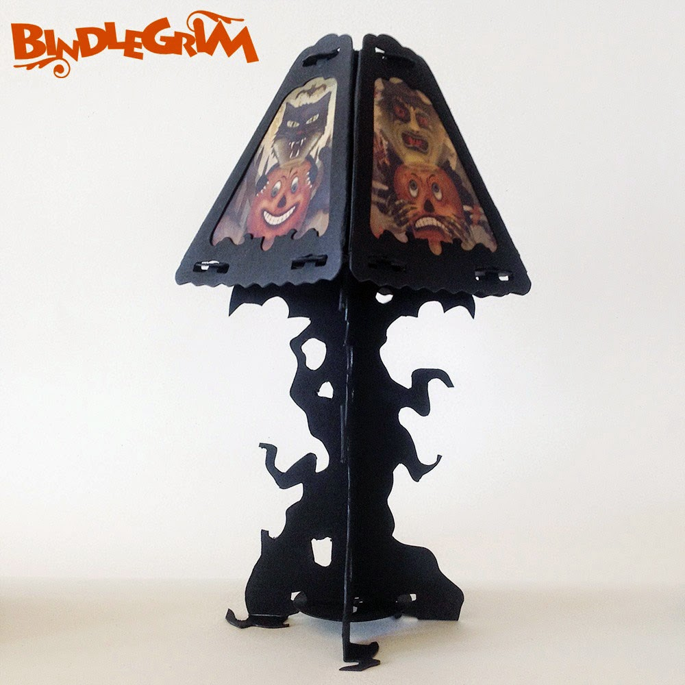 Lamp shade decoration on top of spooky tree silhouette from the Spooklights lighting series by artist Bindlegrim