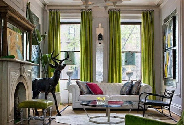 beautiful transitional living room pop of green color