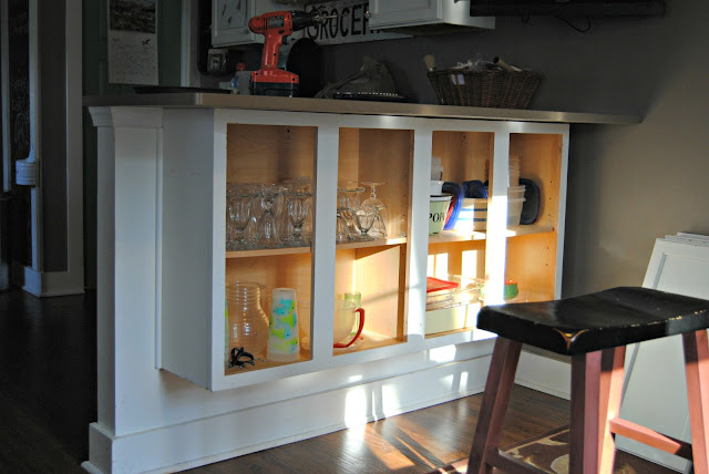 The painted home adding glass doors to my kitchen for Add glass to kitchen cabinets