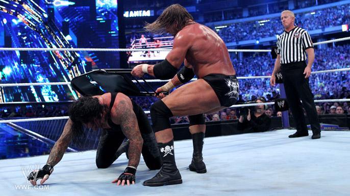 Image result for the undertaker vs triple h wrestlemania 27