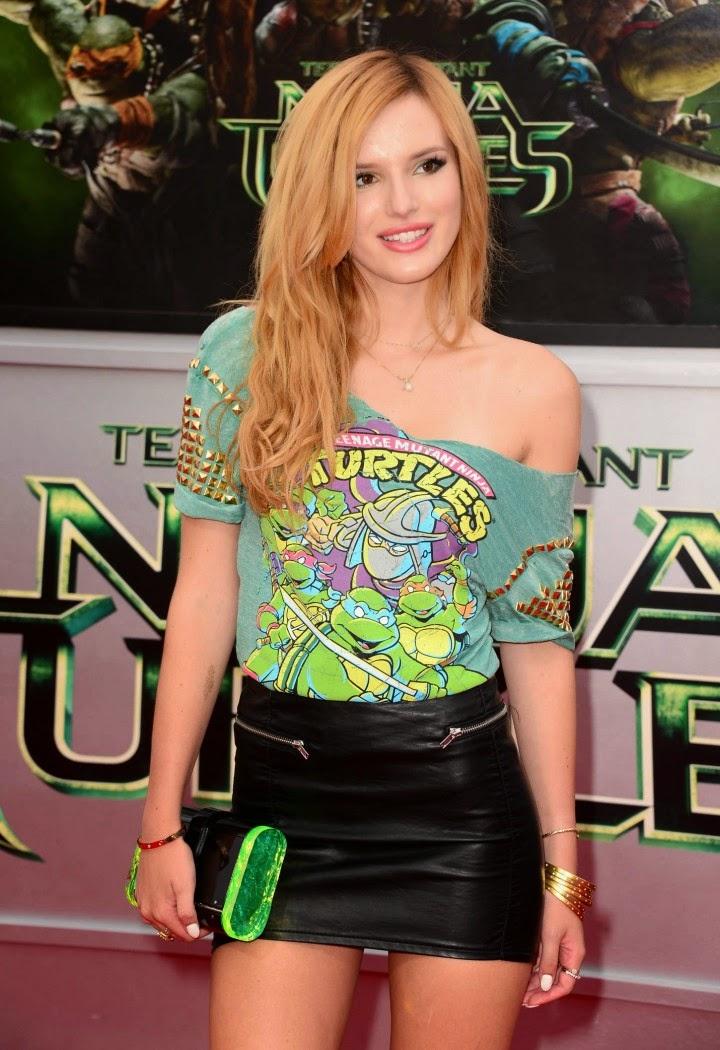 Bella Thorne arrives for the 'Teenage Mutant Ninja Turtles' LA premiere in a leather mini skirt