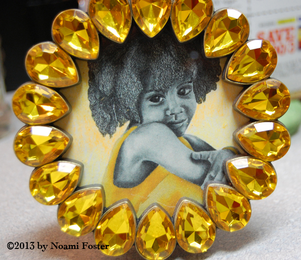 Framed yellow girl notecard inside a charming charlie yelllow jeweled frame
