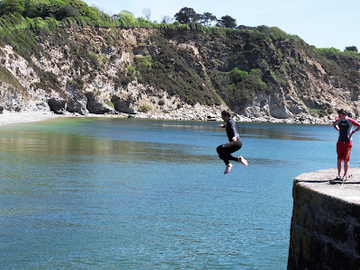 Jumping from harbour walls in Charlestown Cornwall