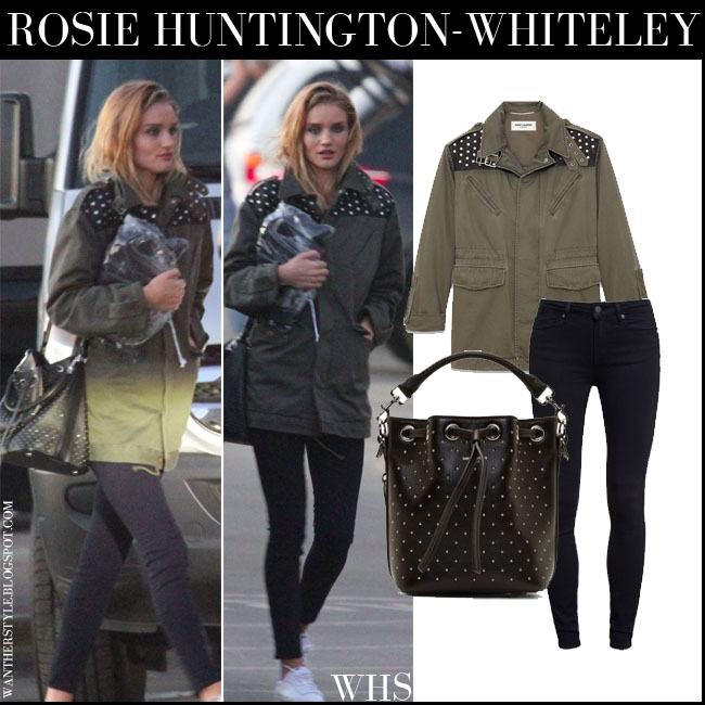 Rosie Huntington-Whiteley in military khaki green Saint Laurent parka, black Paige Denim Hoxton jeans, white sneakers and black bucket Saint Laurent bag what she wore streetstyle july 11