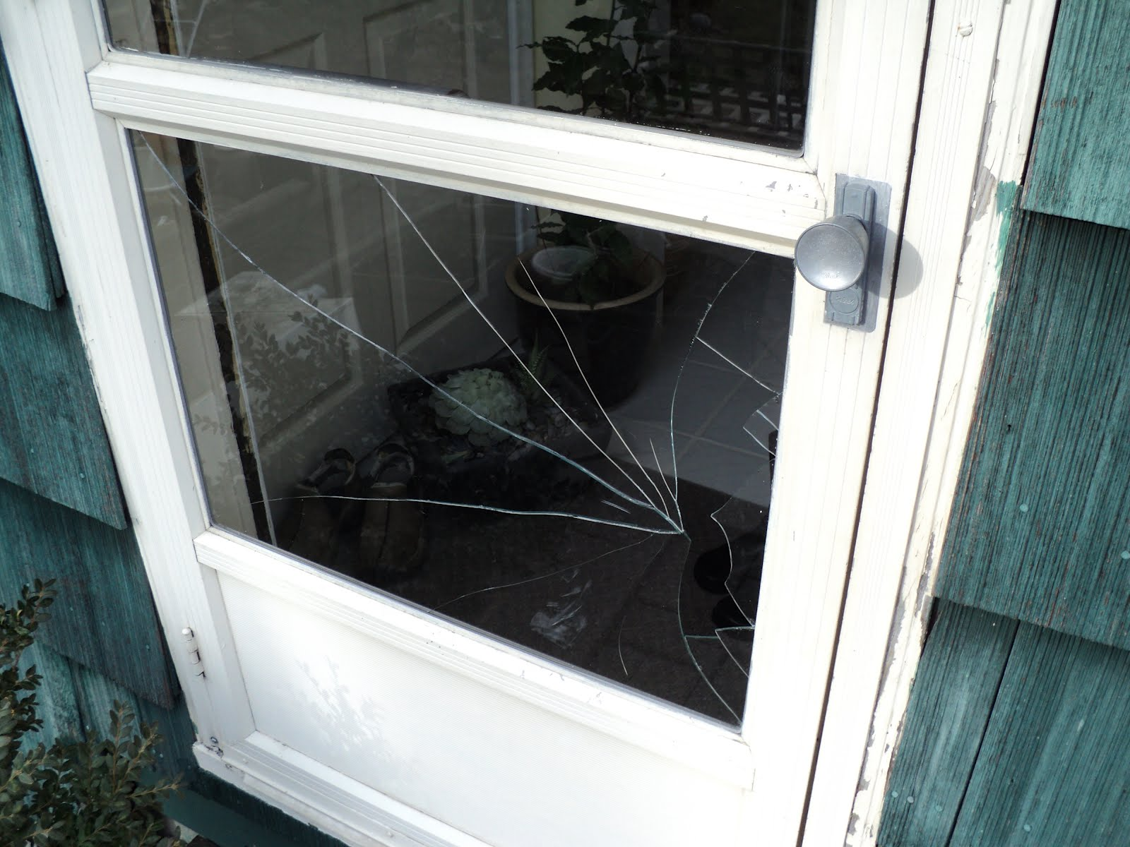 A Storm Door Broken Window Repair