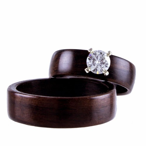 http://northwoodrings.com/all-wooden-rings/ebony-with-5mm-moissanite