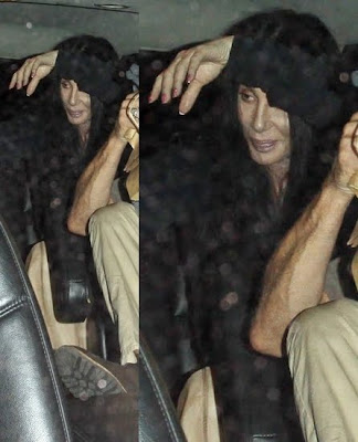 Cher continues to hide her face