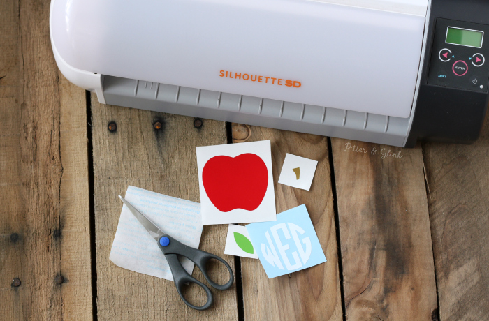 Transfer vinyl pieces using clear contact paper for easy layering. www.pitterandglink.com