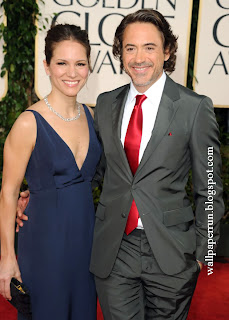 Actor Robert Downey Jr. (R) and producer Susan Downey arrive at the 68th Annual Golden Globe Awards in Beverly Hills
