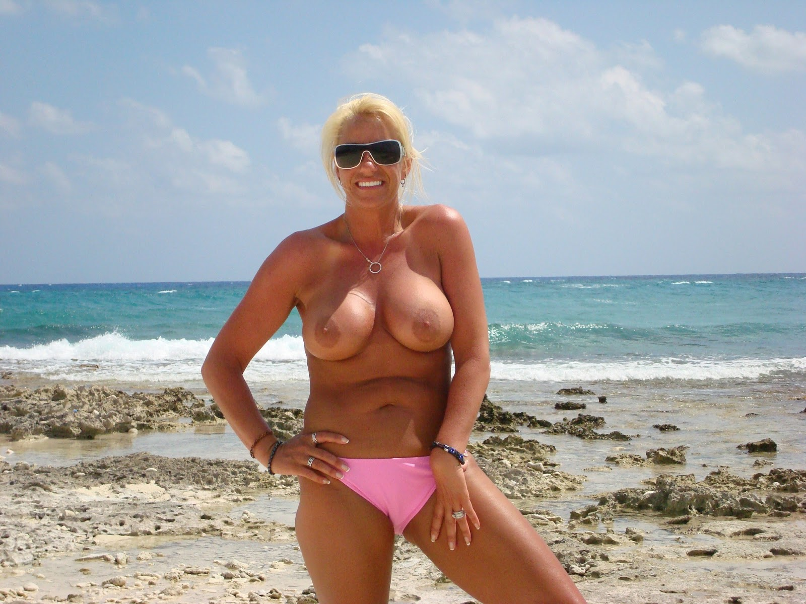 Blonde Granny At The Beach