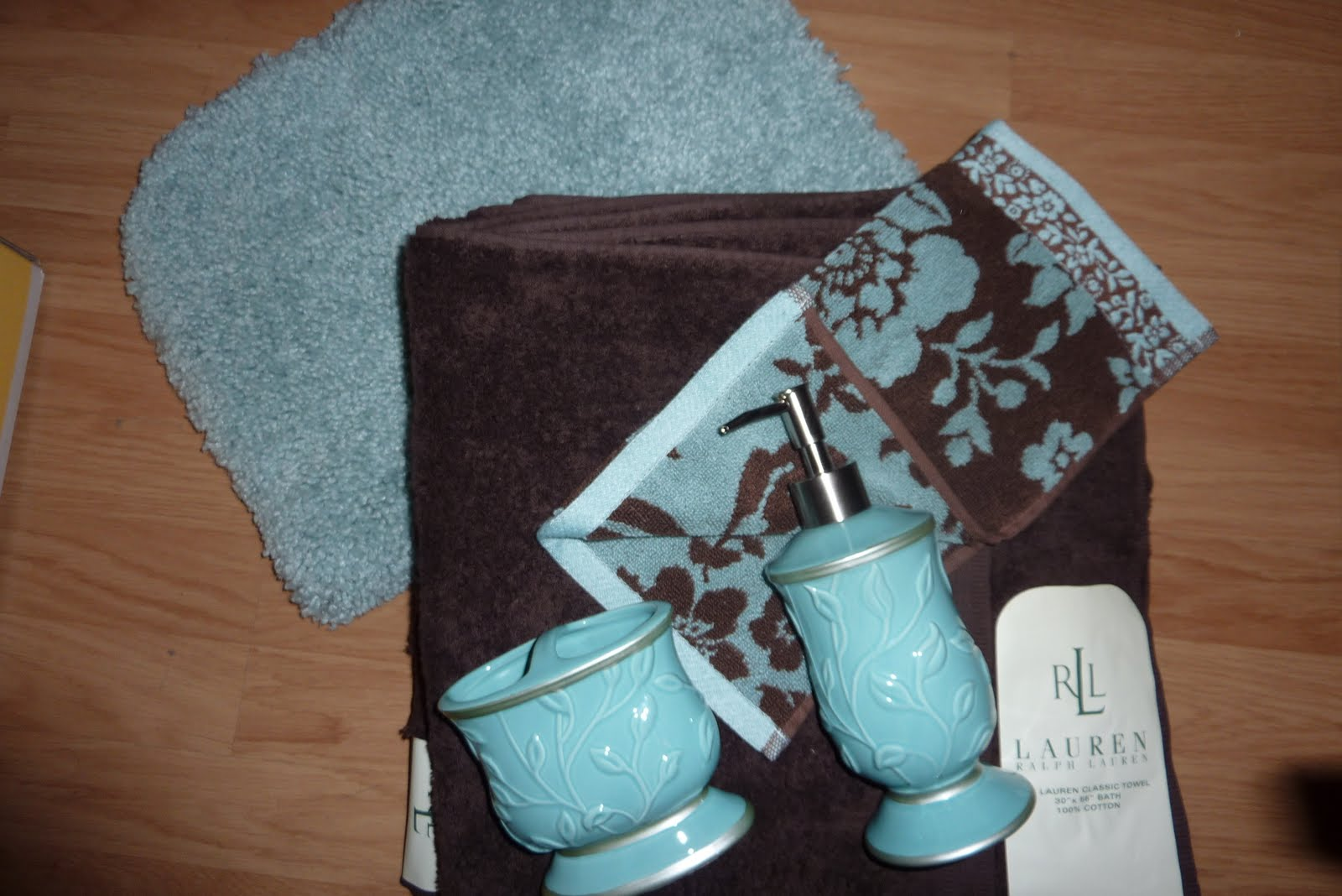 Colors of curacao brown aqua bathroom color inspiration for Aqua blue bathroom accessories