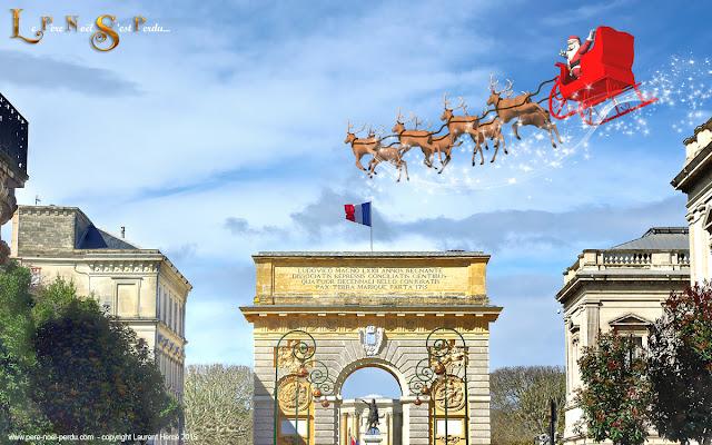 Montpellier : le Père Noël au dessus de l'arc de triomphe du Peyrou