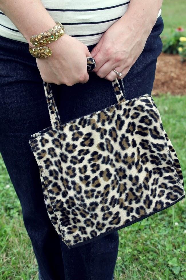 leopard print handbag and lucite clamper bracelet