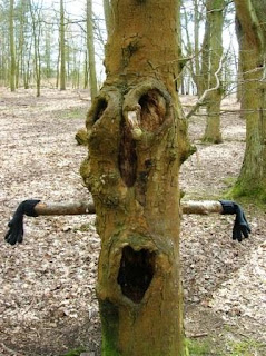 A tree with a face and arms