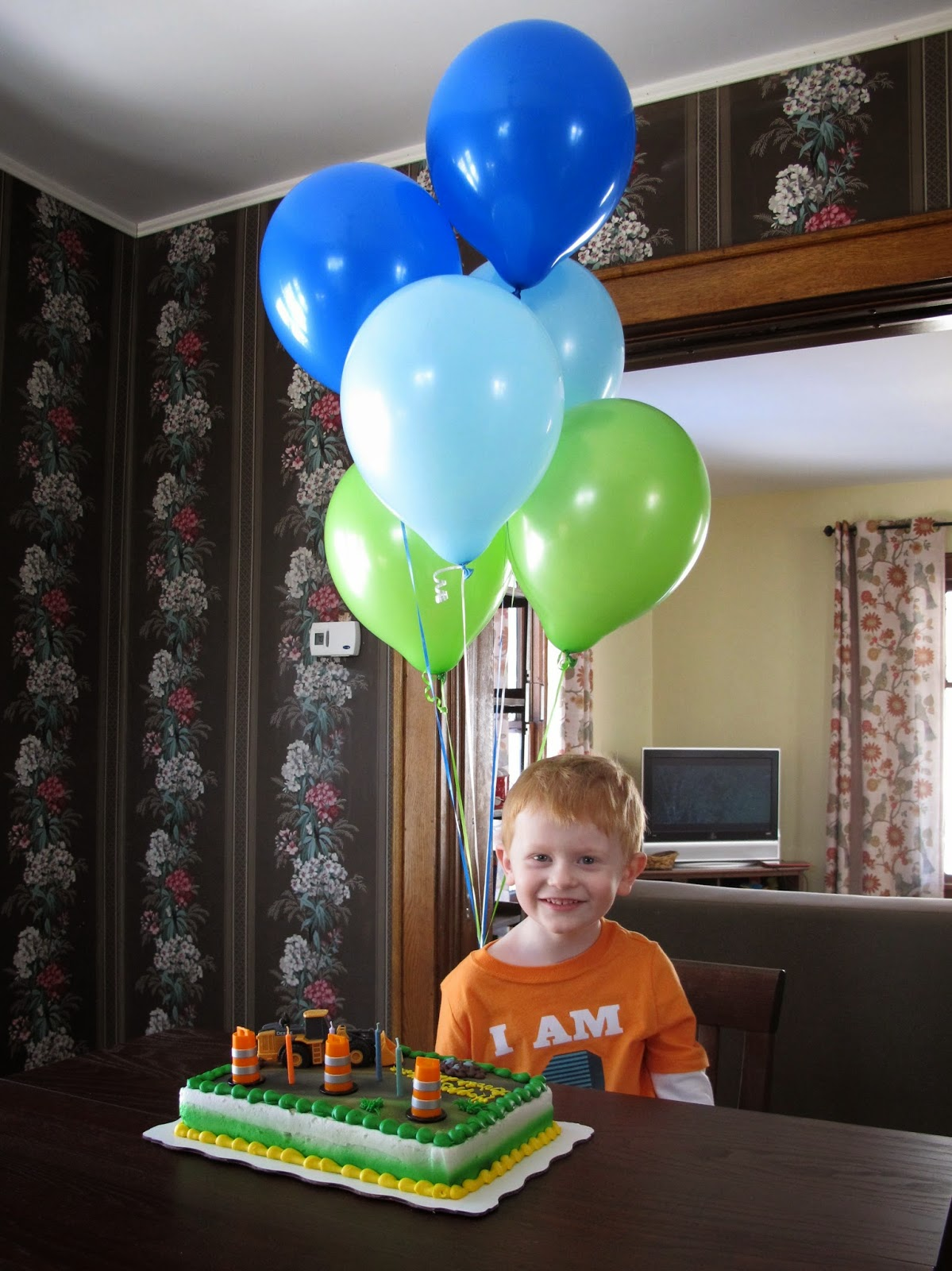 Porter with Balloons & Cake