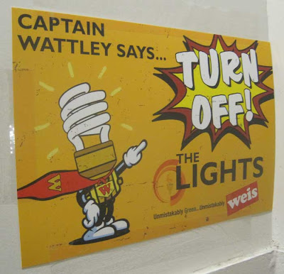 Cartoon superhero made out of a CFL lightbulb with admonition, Captain Wattely says TURN OFF THE LIGHTS