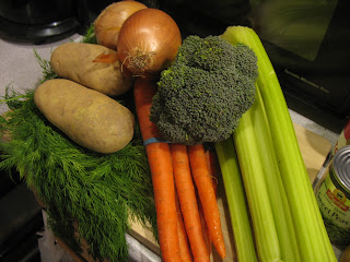 Soup ingredients - Dill, carrots, potatoes, onions, broccoli, and sweet peas