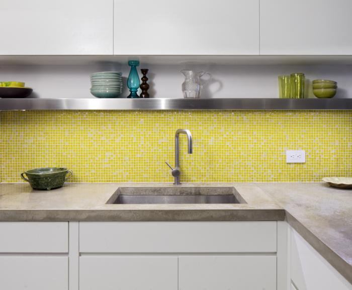 yellow glass tiles of the backsplash as well as the factory style