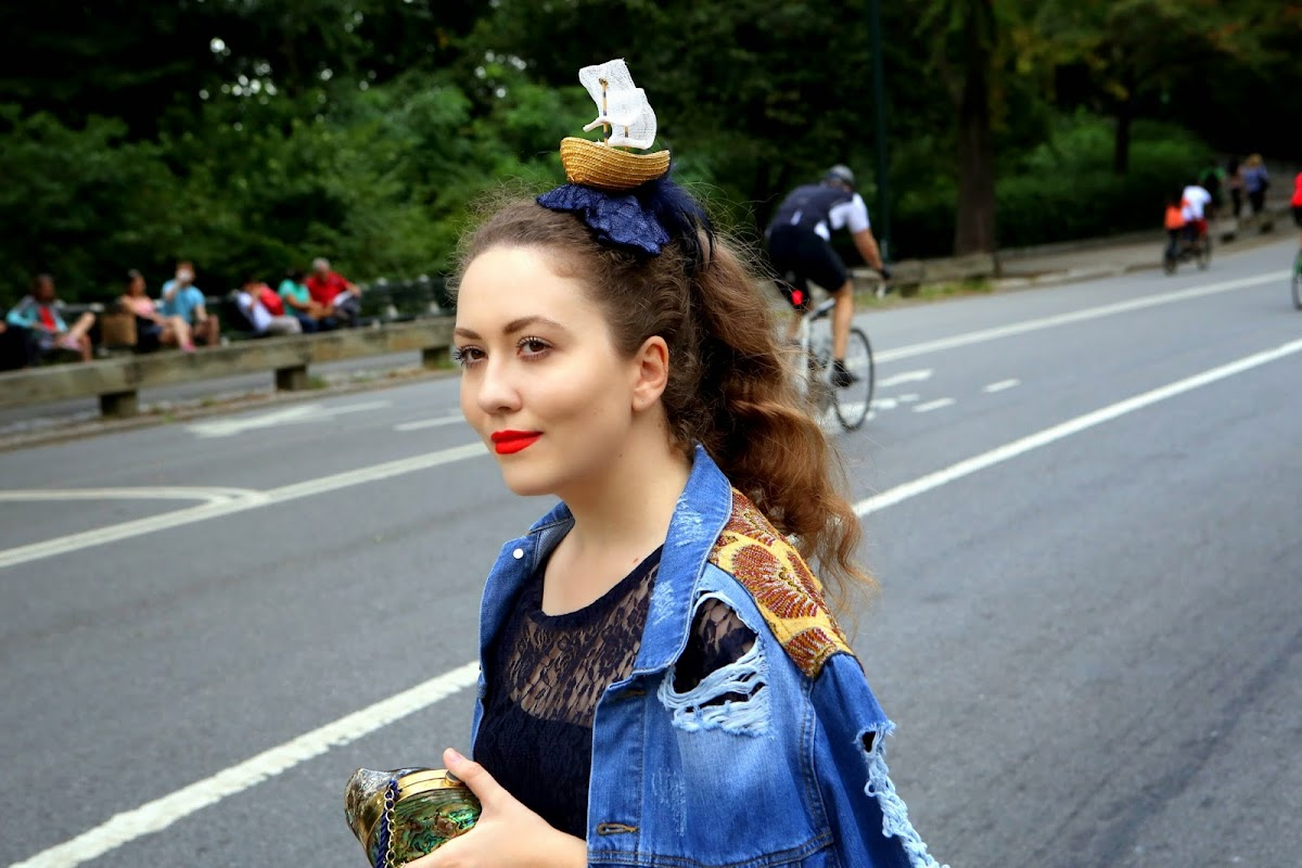 The girl with a ship fascinator on her head