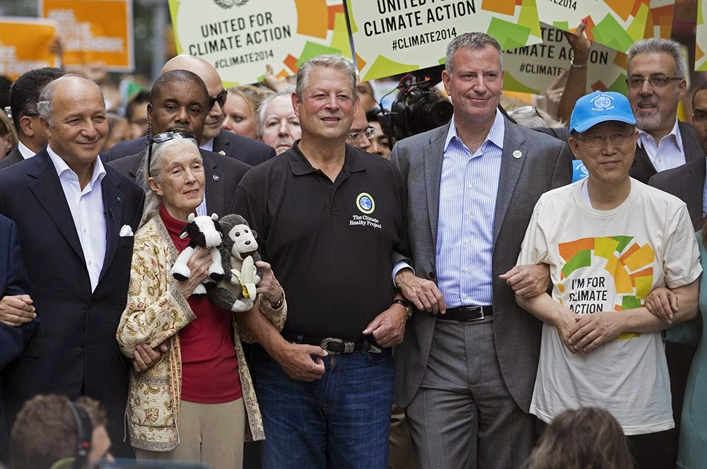Comrades in arms: From left to right, French Foreign Minister Laurent Fabius, primatologist Jane Goodall, former U.S. Vice President Al Gore, New York Mayor Bill de Blasio and U.N. Secretary-General Ban Ki-moon march arm in arm in yesterday's parade in New York to call for action to fight climate change. Photo by Craig Ruttle, courtesy of AP Images.