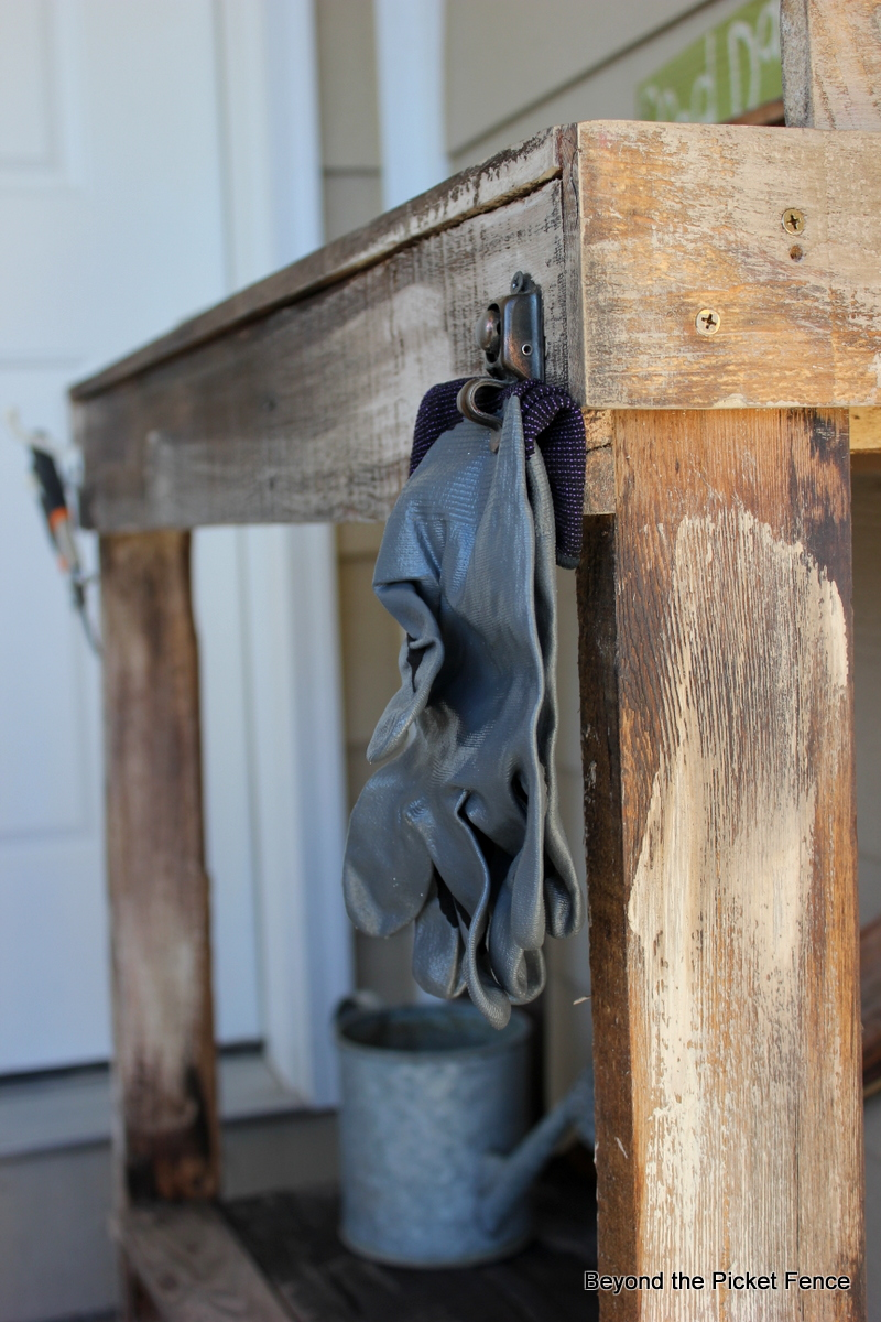 Beyond the picket fence rustic pallet potting bench for Pallet picket fence