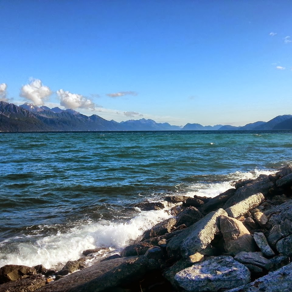 Rocky shoreline of lake with breathtaking moutain range