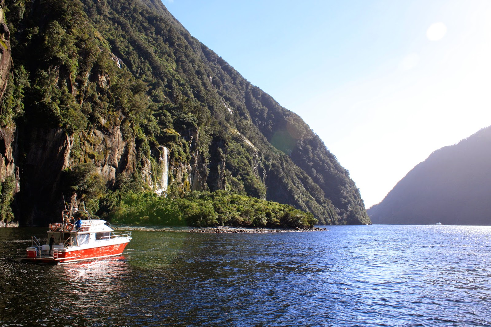 A boat taking a cruise in Milford Sound.